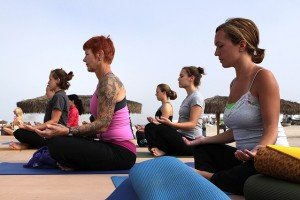 women doing yoga helps blood pressure