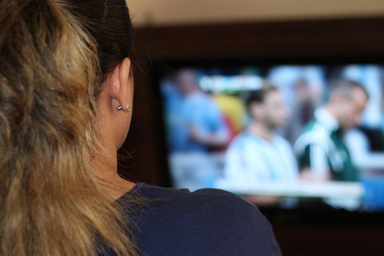 woman binge watching tv